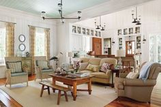 living area with vintage style lights; love the lights, the furniture and the general relaxed feeling!