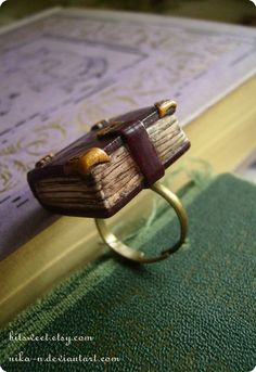 @Kristy Reagan   Old Library book ring by BitSweet on Etsy. $15.00, via Etsy.
