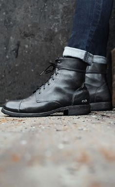 Black leather boot for men by BEDSTU. An easy wear fashion piece, with a lace up front and back zipper. For an informal look, roll denim at the ankle.