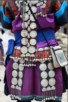 *|* Miao - Guizhou - China.  Miao women's festive attire includes a variety of silver decorations.  The purpose of wearing all this silver is of course primarily aesthetic, but it also shows affluence and is thought to wards off evil spirits.