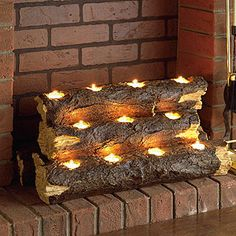 Southern Enterprise Burning Log Fireplace Candelabra - Re-create the rustic charm of a wood fire with the clever Southern Enterprise Burning Log Fireplace Candelabra . This handcrafted resin sculpture resembles. Fireplace Candelabra, Fireplace Lighting, Fireplace Ideas, Fireplace Filler, Fireplace Decorations, Decorating Ideas For Fireplace, Fireplace With Candles, Fall Fireplace Decor, Fireplace Design