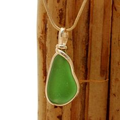 Great vivid piece of natural sea glass in my Original Gold Wire Bezel© a simple design that lets all the beauty of this glass shine. Classic and timeless design that does not alter the sea glass from the way it was found on the beach.
