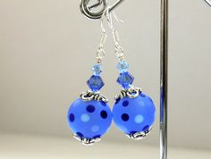Handmade Lampwork Earrings, Beautiful Blue with blue spots and Swarovski Crystals, Sterling silver hooks. $30.00, via Etsy.