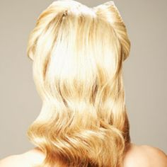 """For '40s-inspired waves...    Hold a 1-inch curling iron horizontal (so it's parallel to the floor) and wrap 2- to 3-inch sections of hair around it. Secure each curl against your head with a metal """"duck bill"""" clip to set it in place. Once you're finished and your hair is cool, mist your whole head with a strong-hold hairspray, remove the clips, and lightly brush out the waves. Finish off with another spritz of hairspray."""