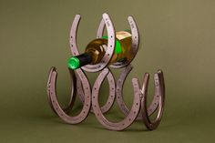 Horseshoe Wine Rack- display three wine bottles cowboy style - Free US Shipping from LizzyandMe on Etsy. Wine Bottle Art, Bottle Rack, Wine Bottle Holders, Wine Bottles, Horseshoe Wine Rack, Horseshoe Art, Horseshoe Ideas, Hanging Wine Rack, Diy Hanging