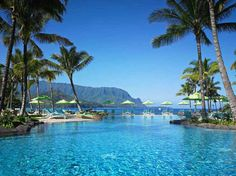 Located in northern Kauai, with views of Hanalei Bay and Bali Hai, the natural beauty that flanks this pool is almost too much. Because it's open 24 hours a day, it's a prime spot to watch both the sunrise and sunset on either side of the island. Nalu Kai Grill & Bar is just steps from Pu'u Poa Beach and does a killer Tai Chi—a spicy rendition of the mai tai.