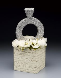 DIY bling wedding centerpiece tutorial.  This can be lit with votives and colors can easily be changed,  You could even add a jewel at the top of the ring!