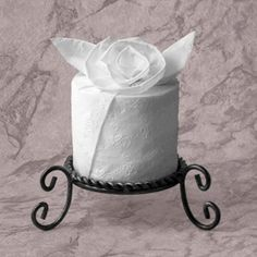 Toilet Paper Origami On a Roll - how to pretty up that extra roll of toilet paper so guests can find it - use large candle holder?