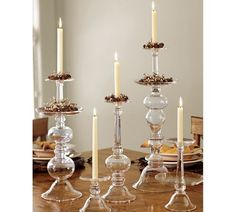 Turn some champagne glasses upside down, glue a crystal candlestick to it and voila, a taller, beautiful candle holder...