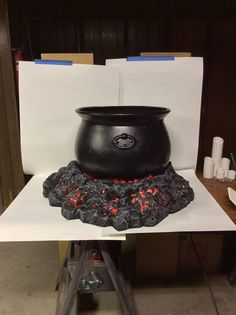 This burning coals cauldron base is sure to be the centerpiece of your Halloween display this year. Made out of durable foam this prop is made not only to be weather resistant but last for years to come. Just add a strand of orange LED lights to give it the perfect glow. These coals have a cutout in the back with piping to direct smoke into the cauldron. Just add your smoke machine complete the look. 30 x 30 x 7 —NPH