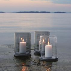 Skargaarden's Moja lanterns, with grey and clear glass. Skargaarden's glassware adds beauty and serenity to every setting. The glass is made by Reijmyre Glassworks, founded in by passionate craftsmen. Outdoor Candle Lanterns, Hurricane Lanterns, Lantern Candle Holders, Chandelier Bougie, Chandeliers, White Candles, Pillar Candles, Romantic Candles, Candels