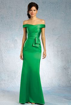 Alfred Angelo. Draped floor-length satin gown with an off-the-shoulder neckline. Belted natural waistline with abstract bow detail and a fit-and-flare skirt.