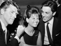 Actors Burt LANCASTER, Claudia CARDINALE and Alain DELON laughing during a press conference held at the Excelsior Hotel in Rome for their film LE GUEPARD, directed by Luchino VISCONTI, on May 4, 1962