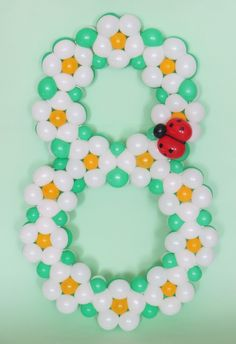 Figure eight of flowers with ladybug.