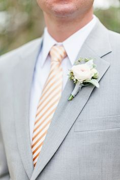 Simple #grey #suit with a pop of color tie. Photo by Brooke Images on Southern Weddings