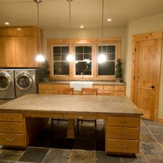All these last office/crafts rooms are from houzz website I like this extra large laundry shared crafts room