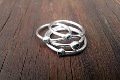 Silver 'digit' rings set with tourmaline stoneBuy them way too small and wear them as midi rings, stack them, or leave gaps between bands to create a.