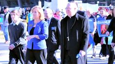 DALLAS: Bishop Kevin Farrell of Dallas, with Karen Garnett (l), executive director of the Catholic Pro-Life Committee, walk to the court house. Facebook/Dallas March for Life