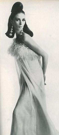 Wilhelmina in a silk chiffon dress trimmed in ostrich feathers by Mort Schrader, photo by Bert Stern for Vogue, 1965