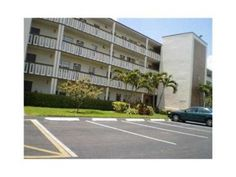 MOVE IN CONDITION - 2/2 WITH BEAUTIFUL WATER VIEW! STORM SHUTTERS ON PATIO. VERY CLEAN, STALL SHOWER. NEW A/C