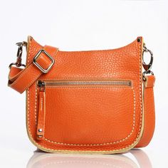 Parisian Saddle in Orange... sigh. I'm obsessed with Roots bags...