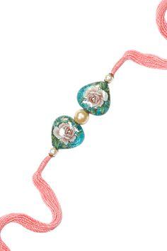 Ra Abta presents Pink bejewelled Japanese bead and pearl rakhi available only at Pernia's Pop-Up Shop. Gold Jewelry, Jewelry Necklaces, Beaded Bracelets, Rakhi Bracelet, Handmade Rakhi Designs, Sock Dolls, Crochet Curtains, Pernia Pop Up Shop, Handmade Jewellery