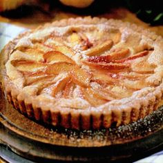 This beautiful dessert is a nice change from the traditional pie — a thin layer of sliced peaches is baked in a buttery egg filling. Make sure to use real butter; margarine and substitutes don't do justice to the recipe.