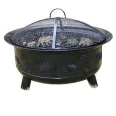 Metal round fire pit with grill panel and hook. Mesh cover on top. Cut out bears and.