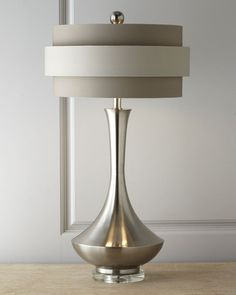 John-Richard Collection Neutral Orbit-Shade Table Lamp, Ultra-contemporary table lamp has an urn-shaped body on a clear acrylic base topped by a double-banded orbit shade in tonal neutrals crowned by a silver-tone sphere. From John-Richard Collection. Interior Lighting, Home Lighting, Modern Lighting, Lighting Design, Lamp Shades, Modern Table, Bedside Lamp, Lamp Light, Floor Lamp