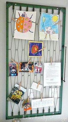 Repurposed baby crib...cute idea for kids art work.
