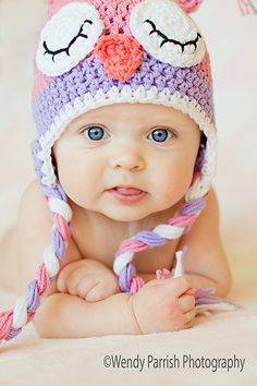 This gorgeous little owl hat features soft almost pastel like colors of of light pink, purple and white. This hat is hand made using soft cotton
