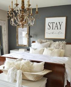 Stay awhile sign, rustic, diy decor, home decor, farmhouse, Master bedroom, elegant, master suit, table, king size bed, home decor must decor, ceiling fan, patterns, off white, l8ght, chandelier, wall art, rug, hardwood floors, pillows, bed frame, plants, master bedroom cozy, retreat #ad #ss