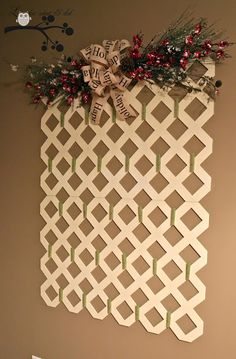 2 pieces of lattice with clothes pins for clipping Christmas Cards.  Lovely idea and could also be used for displaying kids' artwork.