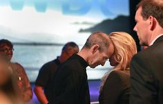 Steve Jobs rests his head against his wife, Laurene Powell Jobs, after delivering the keynote address to the Apple Worldwide Developers Conference at Moscone West on Monday.