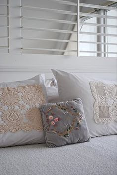 pillows with vintage doilies, maybe on those pillows I got at that garage sale?