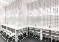 Ukrainian studio AKZ Architectura completely covered the interior of this vegetarian cafe in Kiev with white tiles.