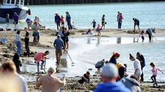 Gold on beach: Gold Rush begins at the beach for Folkestone Triennial Public Art Project on August 28, 2014 in Folkestone, England.