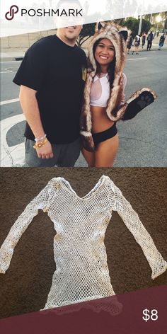 White stretchy net rave top/festival I wore this once to countdown,  I wore a triangle top under it,  would also look super cute with a  bralette or pasties :) Tops