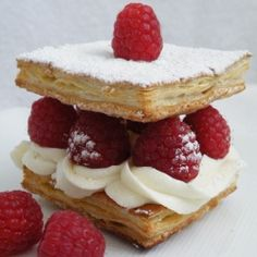 Raspberry Napoleons are an incredibly easy and très délicieux summertime dessert.  The combination of a crisp puff pastry with the sweet cream cheese and raspberries is hard to beat.  The cream cheese mixture can be made a day