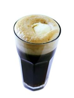 An adult #CokeFloat, a Rum and Coke Float is a #dessert cocktail all in one! // MensJournal.com- #SummerCocktail