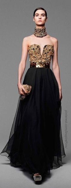 Alexander McQueen - the collar looks torturous but love the dress