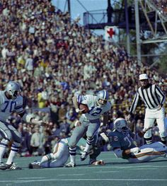 Super Bowl VI -- Dallas Cowboys 24, Miami Dolphins 3  JAN. 16, 1972 (Tulane Stadium, New Orleans) -- Dallas Cowboys quarterback Roger Staubach (12) tries to escape the grasp of Miami Dolphins defender Jim Riley (70) during Super Bowl VI in New Orleans. (AP Photo)