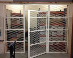 cage fitted in a store room in a commercial building in Middlesex. Cage, The Unit, Storage, Building, Room, Commercial, Spring, Larger, Buildings