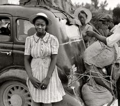 "July 1940. ""Near Shawboro, North Carolina. Group of Florida migrants on their way to Cranberry, New Jersey, to pick potatoes."" Medium-format safety negative by Jack Delano for the Farm Security Administration."