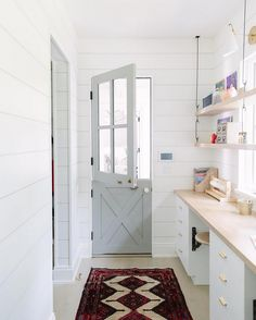 Beautiful mudroom with shiplap, open shelving, a red vintage runner, and a soft blue-gray dutch door. Kate Marker Interiors via Custom Home Builders, Custom Homes, Dutch Door Interior, Interior Doors, Grey Oak, Colorful Interiors, Luxury Homes, Family Room, New Homes