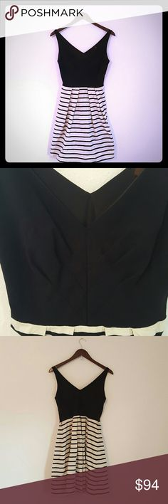 """Anthropologie Eva Franco B&W dress EUC. Anthropologie Eva Franco B&W dress. This dress is so classic and so flattering! Missing the original belt, but you could substitute any bright colored skinny belt and it would look great! Zipper side closure. Length is approximately 36 """". Top is 65% Rayon 30% Nylon 5% spandex Bottom is 100% cotton.  Dry clean only. Anthropologie Dresses Midi"""