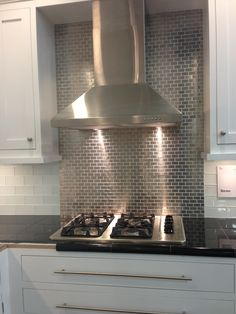 Stainless steel tile backsplash, perhaps for an in kitchen bar area to create a focal area.