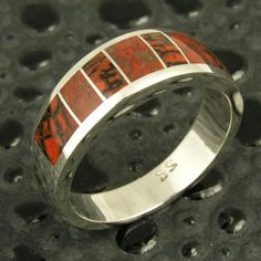 Dinosaur bone ring with 2 different types of dinosaur bone inlaid in sterling silver. This dinosaur bone ring would make a unique man's wedding ring. #dinosaurbonering #dinosaurboneweddingring #uniqueweddingring