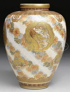 A Japanese Satsuma Pottery, Meiji Period, 1868-1912 Vase, Japan, decoration of dragon and phoenix rondelson a ground of swirling chrysanthemum flowers