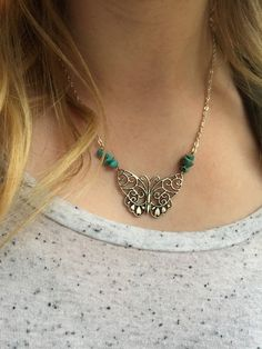 ON SALE for $20. Save $8! Wear this beautiful butterfly and turquoise necklace is a perfect addition to all your outfits. Silver plated